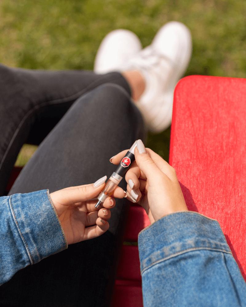 Closeup of a hand holding a cannabis vape