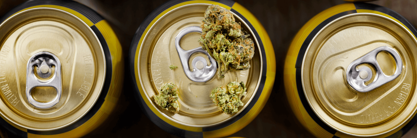Three cans, the center with marijuana leaves on it